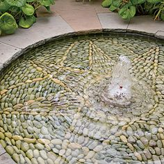 Notice the Details- The Garden on First Street - Southern Living Add texture to a shallow pool with smooth pebbles arranged in a pleasing pattern
