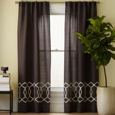 A nice alternative to solid geometry is drapery with one patterned band across the panels. From west elm♡