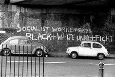 """Socialist Worker Says Black + White Unite + Fight"" graffiti, Downs Park Road, London, England, 1978, photograph by Alan Denney."