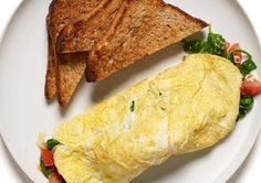 Omelet made with 1 egg and 2 egg whites      Fill it with spinach, tomatoes, and a sprinkle of shredded mozzarella      Eat with 2 slices of whole wheat toast (no butter!)  Total calories: 391 Calories