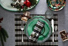 "Bring tartan to the next level with this holiday table decor idea -- black white and green tartan contrast beautifully with solid green plates, a black and white striped plate, classic silverware and traditional red white and silver Christmas ornaments in bowls as an alternative centerpiece. From ""14 Gorgeous Holiday Table Settings"" on the One Kings Lane Style Guide -- Read the full post here!"