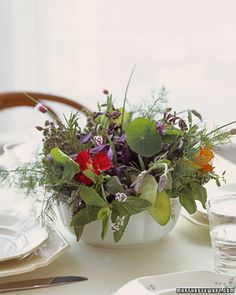 love the idea of fresh herbs and flowers for the centerpieces