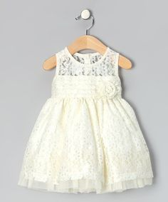 I purchased this for my niece's baptism for only $18.99, it was a beautiful lace dress! Everyone loved it As iridescent and intriguing as a pearl, this dress has lace that glitters and a back that buttons. A tie around the waist complements the full skirt.100% polyesterMachine wash; tumble dryImported