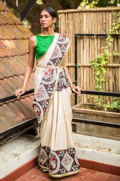 A traditional Kalamkari semi crepe saree with Black White and Red border with a surprise green border edging! Little details make big impact. Truly a Kalamkari with a twist.Our vote is for a striking green blouse pairing. Or tone down the look with a black or a maroon blouse and yet rock the Kalamkari vibe. #kalamkari #saree #india #blouse #houseofblouse
