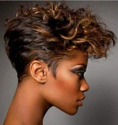 On edge. Love this edgy short cut with highlights.