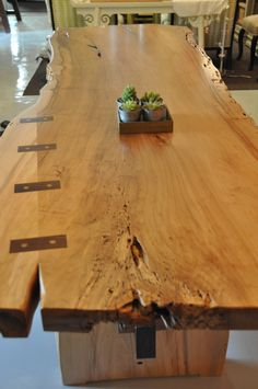carey berkus designs san miguel de allende mexico... custom dining room table out of alimo wood with contrasting butterfly joinery. made in mexico by talented craftspeople,