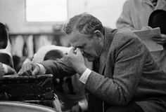 """""""Bear"""" in prayer: University of Alabama football coach Paul """"Bear"""" Bryant kneels in prayer with his team in the dressing room following a 12-7 victory over Ole Miss in the Sugar Bowl  in New Orleans on Jan. 1, 1964."""