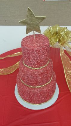 Sparkly Red Christmas cake.  Covered with hand made fondant coated with red sugar crystals and topped with a gilded gumpaste star.