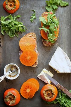 Everything is stacked and layered. Mustard atop the whole grain bread, then prosciutto, sliced persimmon, and fresh arugula.   Yeah, it's serious. We might have stumbled upon the most perfect sandwich situation.