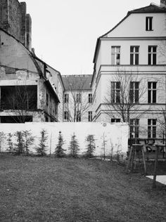 2004: The building on Marienstrasse in Berlin has been fully renovated and the run-down wasteland is now a garden.