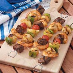 Steak and Shrimp Kabobs Recipe -You'll make any get-together special with these attractive kabobs. Cubes of marinated steak are skewered with shrimp, mushrooms, tomatoes, green peppers and onions, then grilled. For picnics, I assemble the kabobs at home and carry them in a large container. -Karen Mergener, St. Croix, Minnesota