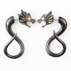 "Horn ""Dragons"" Earrings -Tribal Earrings are truly stunning, with an amazing depth of detail right down to the eyes carved out and intricately inlaid from bone! Wearing each fake gauge is truly wearing art as opposed to looking at it!"