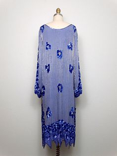 This is a STUNNING vintage dress by Sister Max heavily embellished with glass beading and sequins and accented with tiny pearl beads in an amazing floral abstract design. ‣ Its in excellent vintage condition. ‣ Measurements ‣ Bust - 36/38 Waist - 36/38 Hips - 40/42 Total Length - 44 Tag Size - medium ‣ This dress comes from a pet-free and smoke-free home. ‣ If you would like more info or have any questions, please dont hesitate to ask