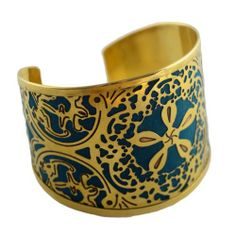Fair Trade Teal Blossom Cuff VavaVida. $23.95. Fair Trade - Hand Made in India. Adjustable and Flexible - fitting most wrists. Purchase of the Teal Blossom Cuff Supports Education for the Children of the Co-op Artisians. Intricate Cutwork of Brass Metal with Teal Colored Fabric Backing.. Gleaming Brass Finish