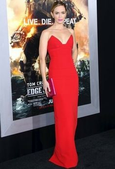 Emily Blunt in a red strapless #Prada gown