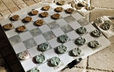 Handbuilt Pottery Checker Board - Complete Game Set with Butterfly and Dragonfly pieces. $58.00, via Etsy or www.amandasanford.com.