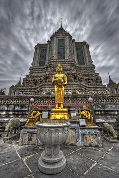 Golden Buddha statue at Wat Arun (Temple of Dawn) in Bangkok, Thailand.