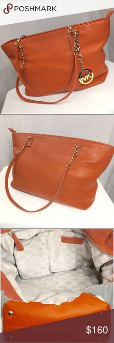 MICHAEL MICHAEL KORS JET SET CHAIN TOTE TANGERINE This genuine leather tote has been gently loved.  It's not perfect, but in very good condition.  There are two minor wear spots on the front corners on the bottom of the bag. Please see the photo. MICHAEL Michael Kors Bags Shoulder Bags