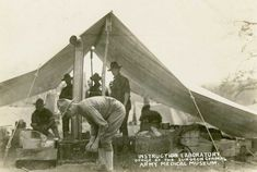 Soldiers cooking in a field kitchen under a canvas tent during World War I. Troops, Soldiers, Army Tent, Canvas Tent, Camping Meals, World War I, Outdoor Cooking, Usmc, Wwi