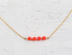 Icing - coral orange beads on gold filled chain necklace - simple delicate jewelry. $22.00, via Etsy.
