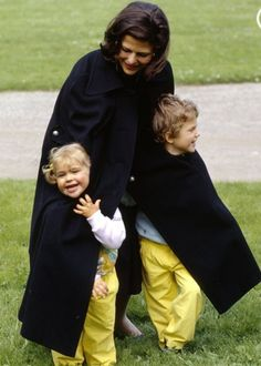 Queen Silvia with her little Madeleine and Carl Philip