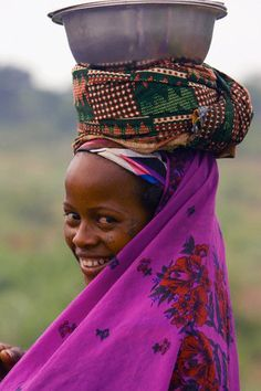 Peul tribe woman in northern Benin, West Africa, on the road after going to the market.