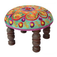 Round Footstool - Atop its beautifully turned mango wood legs is a plump surface upholstered with luxurious velvet in a multihued floral motif