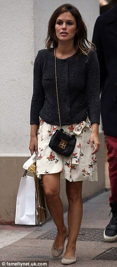 Bronzed: Rachel Bilson looked stylish in a white skirt with a grey jacket and a pair of flat pumps