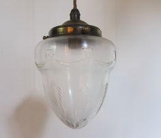 English pendant light in a patinated brass finish, complemented by period cut glass shade. c 1910  www.antiquelightingcompany.com