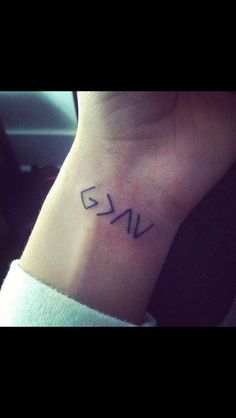 God is greater than the highs and lows. I want this but with the life symbol at the end Logan Woodard