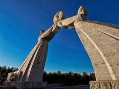 Arch of Reunification (South of Pyongyang, North Korea) The Arch of Reunification was built to recognize and commemorate the proposals for Korean reunification set forth by Kim Il-sung. Made of concrete and depicting two women holding a sphere together, it reaches over the Reunification Highway, which leads to the DMZ.