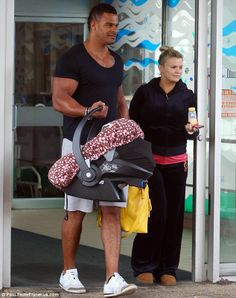 http://news-all-the-time.com/2014/04/10/kerry-katona-leaves-hospital-with-george-kay-and-baby-daughter-after-traumatic-birth/ - Kerry Katona leaves hospital with George Kay and baby daughter after 'traumatic birth'  - By Sarah Bull  Kerry Katona has left hospital after giving birth to her first child with fiancé George Kay. The 33-year-old star welcomed her daughter, whose name has yet to be revealed, into the world on April 4th, in what she has admitted was a 'very tr