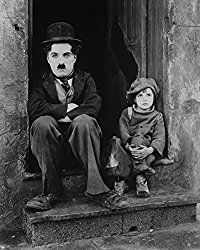 The Kid - Charlie Chaplin's first full-length movie, and possibly his finest. Starring Charlie Chaplin, Edna Purviance, and a young Jackie Coogan    http://famousclowns.org/charlie-chaplin/movie-reviews/the-kid-1921-starring-charlie-chaplin-jackie-coogan-edna-purviance/