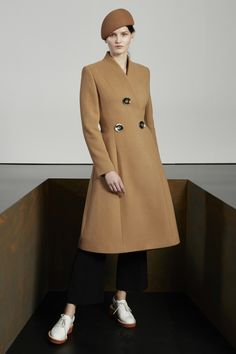 Camel Wool Melton Penrose Coat, Black Dry Wool Tailoring Eden Trousers, White Alter Nappa Odette Lace-Up Slingback and Camel Felt Wool Hat.