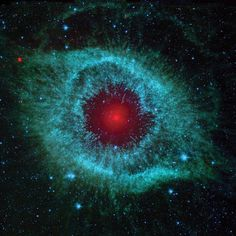 This infrared image from NASA's Spitzer Space Telescope shows the Helix nebula, a cosmic starlet often photographed by amateur astronomers for its vivid colors and eerie resemblance to a giant eye.The nebula, located about 700 light-years away in the constellation Aquarius, belongs to a class of objects called planetary nebulae. Discovered in the 18th century, these colorful beauties were named for their resemblance to gas-giant planets like Jupiter.Planetary nebulae are the...