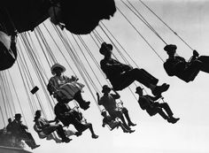 """hauntedbystorytelling: """"Hanging Chairs, amusement ride at Hampstead Fair, London, August 1923 (Topical Press Agency / Getty Images) / src: ilpost. Photography Essentials, City Photography, Vintage London, Old London, Black And White City, Urban Life, Vintage Pictures, Vintage Photographs, History"""