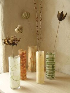 These graceful vases take about 60 seconds to make: 20 seconds to cut the paper, 20 to brush it with glue and 20 to wrap it around a glass...
