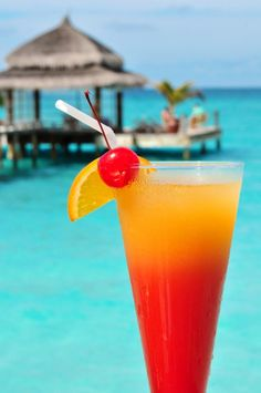 Beach ~ 1 1/2 oz vodka 1/2 oz peach schnapps 2 oz cranberry juice 2 oz orange juice