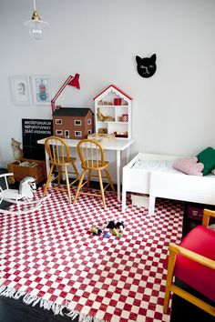 love this red and white handmade checked rug in kids room