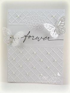 pretty white on white wedding card...especially like how the embossed background leaves space for the message and has small pearls on some of the crossing points of the grid... #WeddingCards