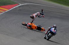 PICS: Pedrosa highside after Marquez contact. Pedrosa comes second again in 2013, fortuantely he is Spanish and will race for Honda next year as well.
