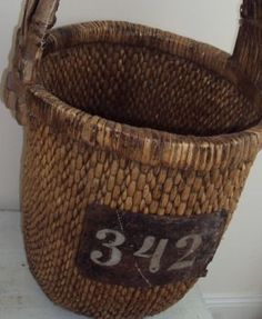 This is actually a European house number I picked up at one of the vintage import places. I bought several of them and I have them scattered around the house. Here I added it to a Chinese Basket I also found there.