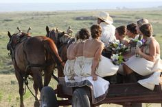 Cowboy Wedding-wedding party entry on a carriage. Love this!