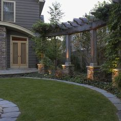 Lovely Curved Pergola to add architecural interest, privacy, and shade. Like the stone base, curved edges of the wood