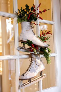 Dig up your childhood ice skates for a DIY outdoor Christmas decoration that embraces nostalgia. Tuck fresh greenery into the tops of the shoes and between the blades, then hang the skates by their laces from a hook on your door. Best Outdoor Christmas Decorations, Christmas Lights Outside, Christmas House Lights, Christmas Greenery, Decorating With Christmas Lights, Christmas Porch, Light Decorations, Holiday Decorating, Decorating Ideas