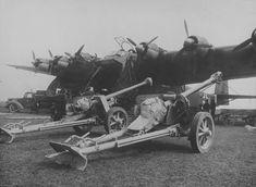 """Aircraft - Des canons anti-char PaK 40 de 75mm prêts à être chargés dans un avion de transport allemand Messerschmitt Me 323 """"Gigant""""   by ww2gallery ~ BFD"""