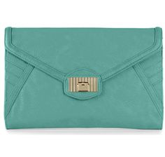 This MIA Oversized Clutch from the Danielle Nicole Handbag Collection is an excellent way to add a modern edge to any outfit, dressy or casual. #holiday #gifts #christmas
