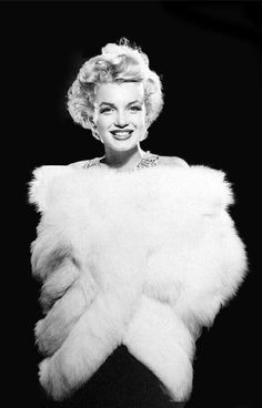 photo by Richard Avedon, 1954  Love this.  I have a white fur wrap just like this.  I will be wearing this out for Valentine's Day.  Thanks Marilyn for the inspiration