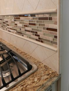 backsplash - like the glass and stone backsplash look. But its too much for me. Want to make less of a statement