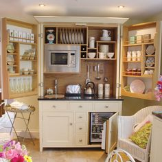 Kitchen in a cabinet - for your kitchenette in the basement @Cris Tanner
